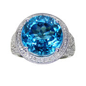 LIMITED QUANTITIES  Genuine Blue Topaz and 1/3 CT. T.W. Diamond Sterling Silver Ring